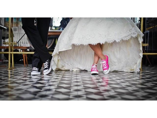 Bride and groom wearing sneakers